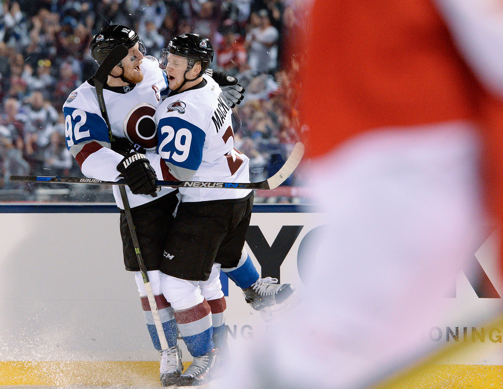 . Colorado Avalanche center Nathan MacKinnon (29) celebrates his goal with Colorado Avalanche left wing Gabriel Landeskog (92) against the Detroit Red Wings February 27, 2016 at Coors Field. (Photo By John Leyba/The Denver Post)
