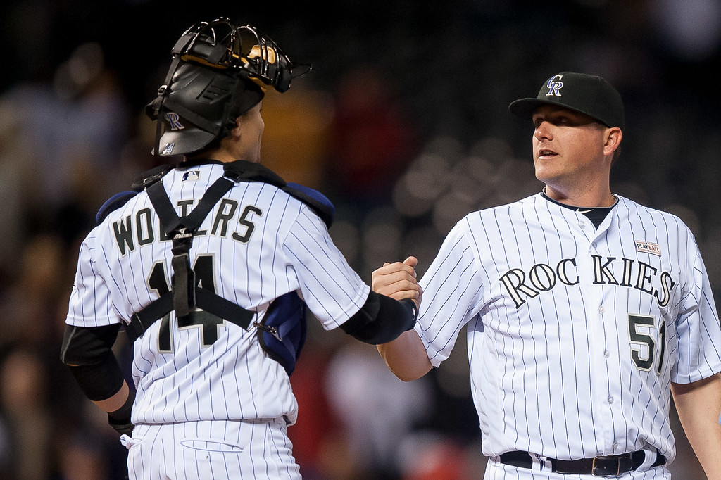 . Tony Wolters #14 of the Colorado Rockies celebrates the 7-4 win over the New York Mets with Jake McGee #51   at Coors Field on May 14, 2016 in Denver, Colorado.  (Photo by Dustin Bradford/Getty Images)
