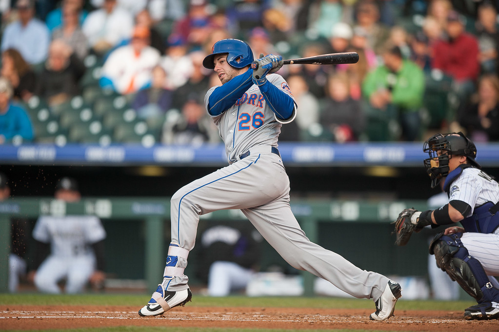 . Kevin Plawecki #26 of the New York Mets hits a 2nd inning RBI single to score Lucas Duda #21 against the Colorado Rockies   at Coors Field on May 14, 2016 in Denver, Colorado.  (Photo by Dustin Bradford/Getty Images)