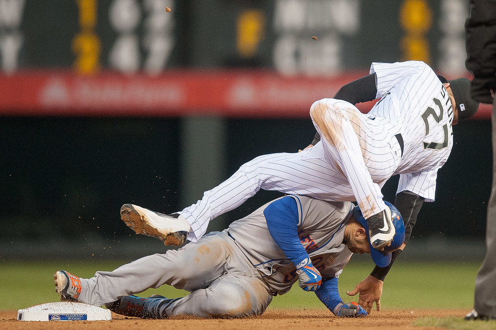 . Trevor Story #27 of the Colorado Rockies collides with David Wright #5 of the New York Mets after turning a double play to end the fifth inning of a game  at Coors Field on May 14, 2016 in Denver, Colorado.  (Photo by Dustin Bradford/Getty Images)