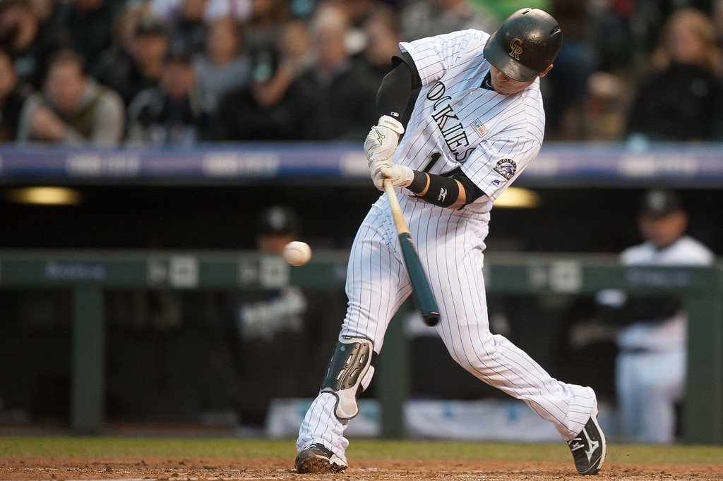 . Tony Wolters #14 of the Colorado Rockies hits a 2-RBI third inning double against the New York Mets  at Coors Field on May 14, 2016 in Denver, Colorado.  (Photo by Dustin Bradford/Getty Images)