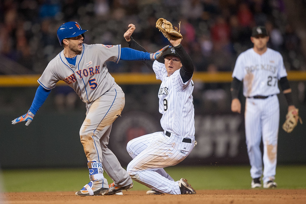 . David Wright #5 of the New York Mets appeals to the umpire that he is safe with a seventh inning double ahead of a tag attempt by DJ LeMahieu #9 of the Colorado Rockies at Coors Field on May 14, 2016 in Denver, Colorado.  (Photo by Dustin Bradford/Getty Images)