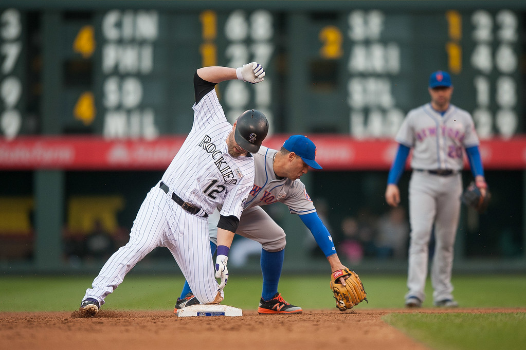 . Mark Reynolds #12 of the Colorado Rockies slides safely into 2nd base ahead of a tag by Asdrubal Cabrera #13 of the New York Mets in the second inning of a game   at Coors Field on May 14, 2016 in Denver, Colorado.  (Photo by Dustin Bradford/Getty Images)