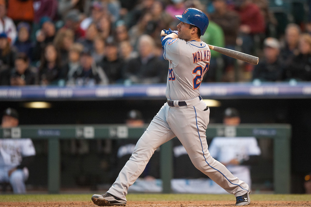 . Neil Walker #20 of the New York Mets watches the flight of a fourth inning solo home run hit off of Eddie Butler #31 of the Colorado Rockies during a game  at Coors Field on May 14, 2016 in Denver, Colorado.  (Photo by Dustin Bradford/Getty Images)