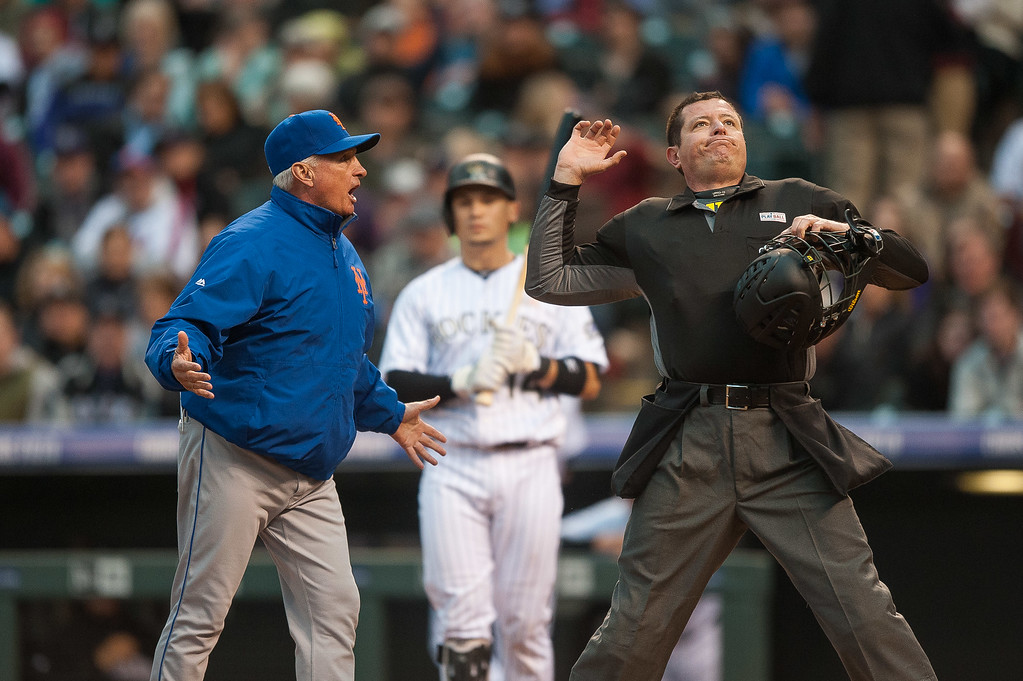 . Terry Collins #10 of the New York Mets is thrown out of the game by umpire Carlos Torres after arguing that Tony Wolters #14 of the Colorado Rockies was out with a strike out in the third inning of a game   at Coors Field on May 14, 2016 in Denver, Colorado.  (Photo by Dustin Bradford/Getty Images)