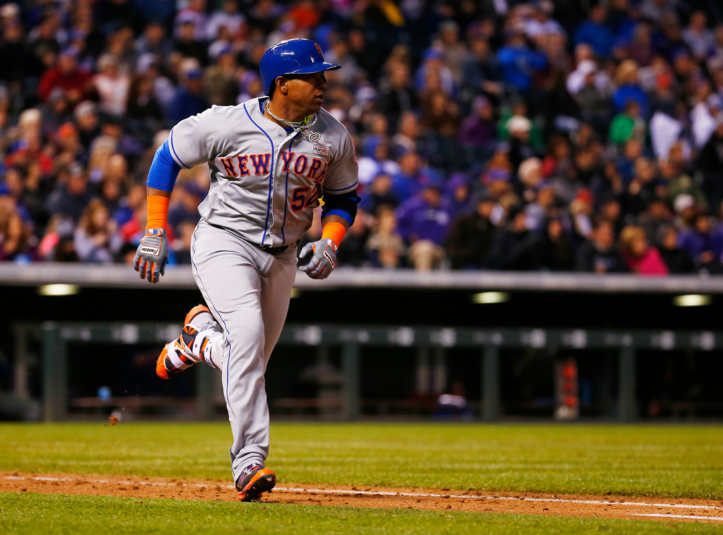 . New York Mets\' Yoenis Cespedes runs to first after hitting a triple off Colorado Rockies starting pitcher Eddie Butler during the sixth inning of a baseball game Saturday, May 14, 2016, in Denver. (AP Photo/Jack Dempsey)
