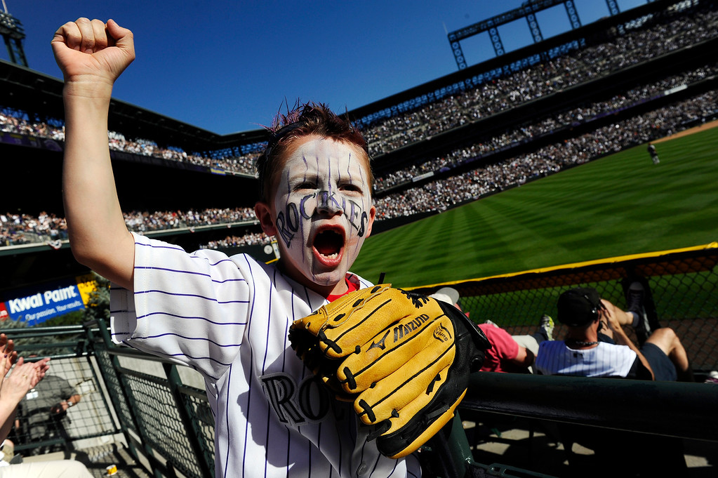 . Cooper Hertz, 7, cheers as the Rockies tie the score, 6-6, in the bottom of the 7th inning during the Colorado Rockies Opening Day game against the Arizona Diamondbacks at Coors Field in Denver, CO, Friday, April 01, 2011.  (Craig F. Walker/ The Denver Post)