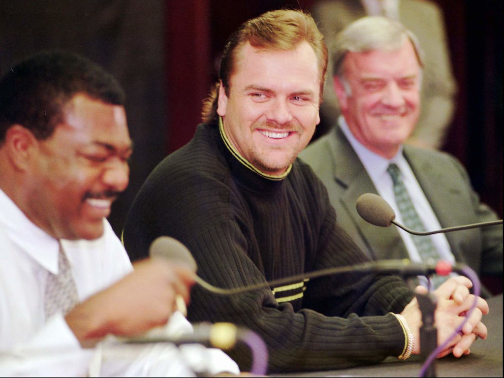 . Colorado Rockies right fielder Larry Walker, center, jokes with manager Don Baylor, left,  and owner Jerry McMorris after being named the National League Most valuable Player in Denver\'s Coors Field on Thursday, Nov. 13, 1997. Walker, who hit .366 with 49 home runs and 130 RBIs, is the first Canadian in either league to win the honor. (AP Photo/David Zalubowski)