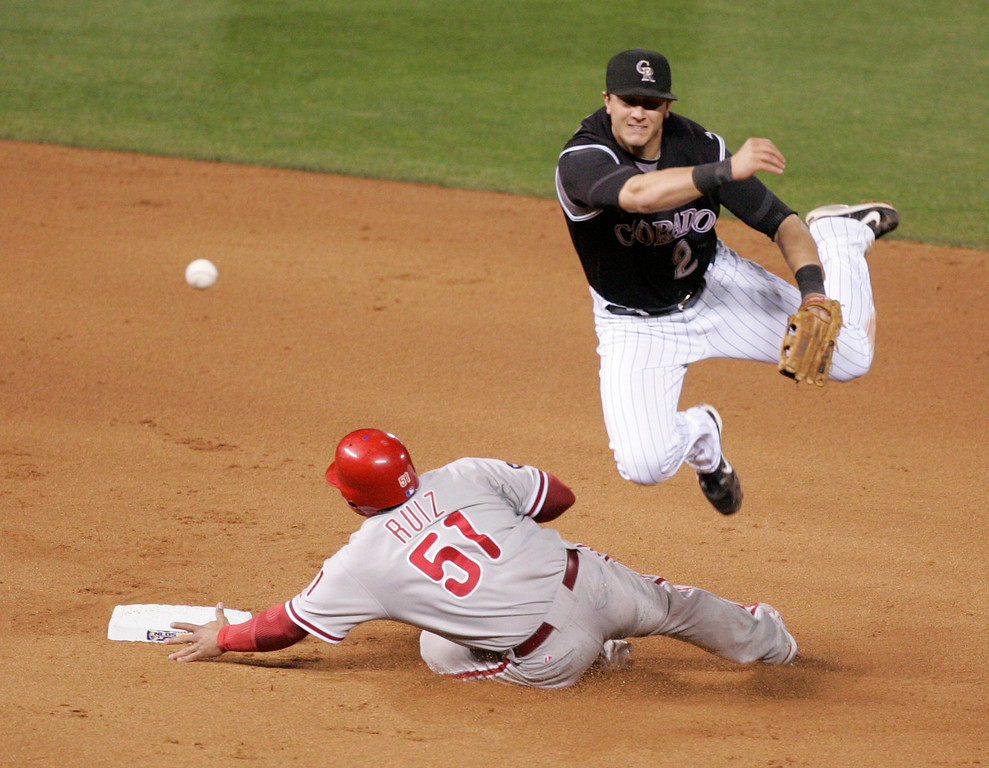 . Colorado Rockies\' Troy Tulowitzki, right, fires to first to complete a double play after forcing Philadelphia Phillies\' Carlos Ruiz at second during the fifth inning of Game 3 of a National League baseball division playoff series Saturday, Oct. 6, 2007, at Coors Field in Denver. Abraham Nunez was out at first. (AP Photo/Will Powers)