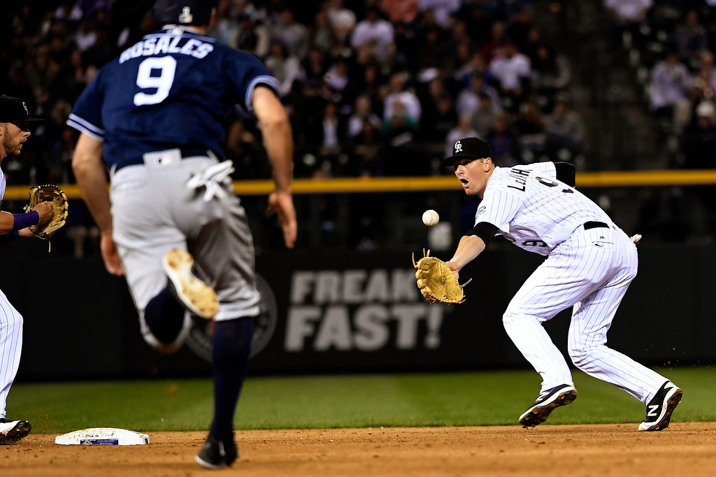 . DJ LeMahieu (9) of the Colorado Rockies flips the ball to Trevor Story (27) of the Colorado Rockies to get the double play against the San Diego Padres at Coors Field. April 09, 2016 in Denver, CO. (Photo By Joe Amon/The Denver Post)