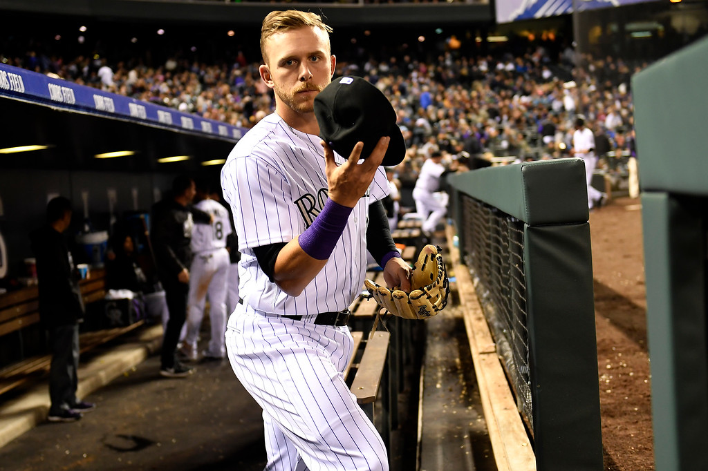 . Trevor Story (27) of the Colorado Rockies heads to the field late in the game against the San Diego Padres at Coors Field. April 09, 2016 in Denver, CO. (Photo By Joe Amon/The Denver Post)