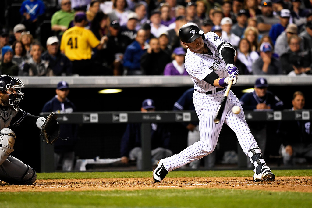 . Trevor Story (27) of the Colorado Rockies drives a base hit against the San Diego Padres at Coors Field. April 09, 2016 in Denver, CO. (Photo By Joe Amon/The Denver Post)