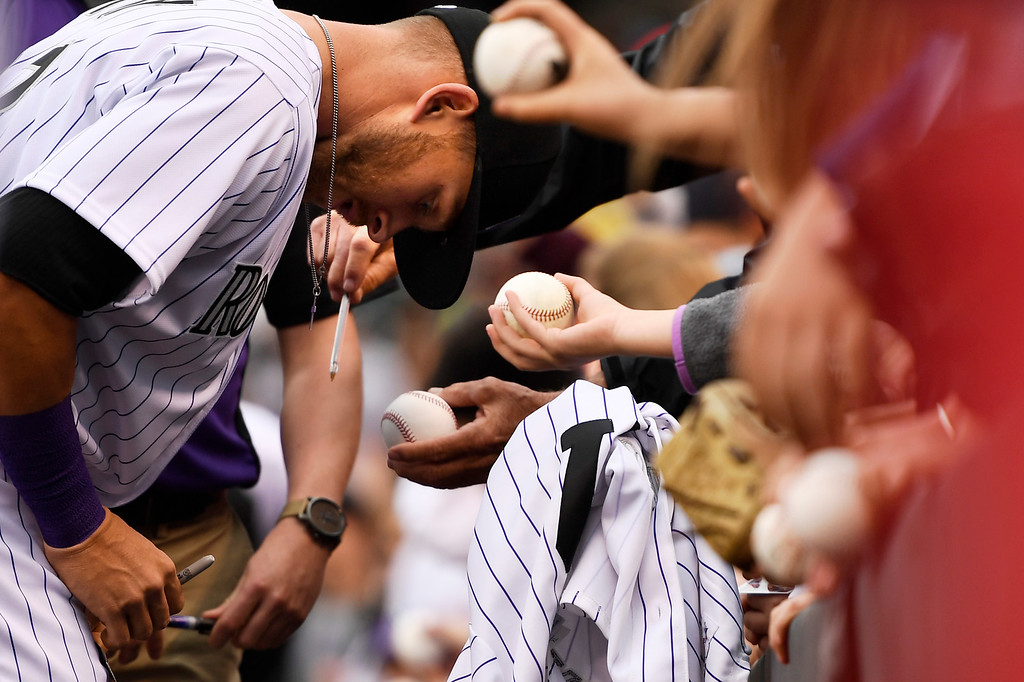. Trevor Story (27) of the Colorado Rockies signing autographs before the Colorado Rockies San Diego Padres game at Coors Field. April 09, 2016 in Denver, CO. (Photo By Joe Amon/The Denver Post)