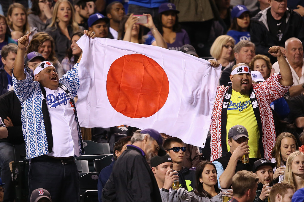 . Fans display the Japanese flag in support of starting pitcher Kenta Maeda #18 of the Los Angeles Dodgers as he earned the win against the Colorado Rockies at Coors Field on April 23, 2016 in Denver, Colorado. The Dodgers defeated the Rockies 4-1.  (Photo by Doug Pensinger/Getty Images)