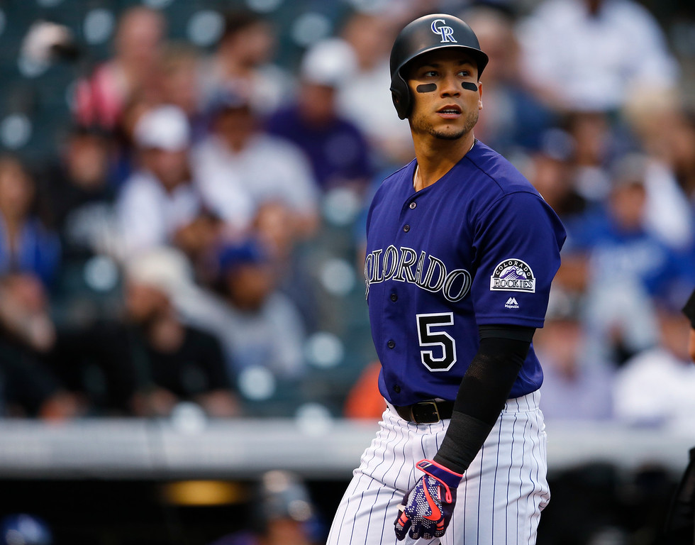 . Colorado Rockies\' Carlos Gonzalez reacts after striking out against Los Angeles Dodgers starting pitcher Kenta Maeda in the first inning of a baseball game Saturday, April 23, 2016, in Denver. (AP Photo/David Zalubowski)