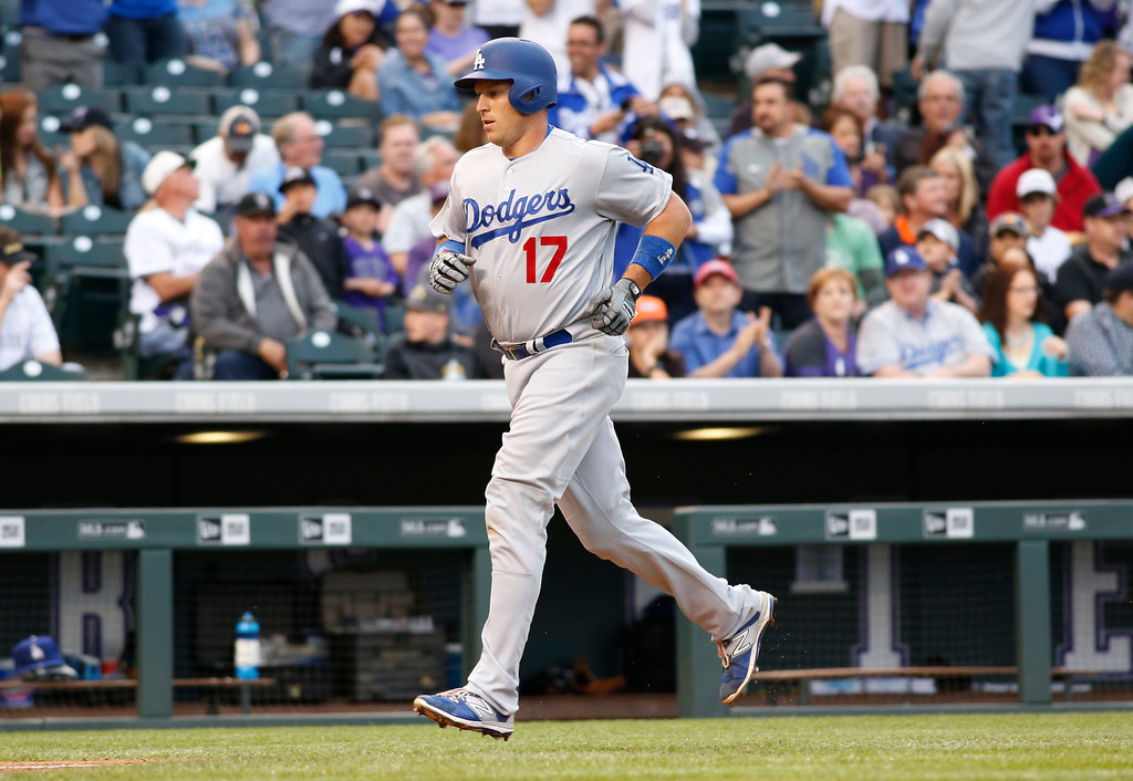 . Los Angeles Dodgers\' A.J. Ellis circles the bases after hitting a two-run home run off Colorado Rockies starting pitcher Tyler Chatwood in the second inning of a baseball game Saturday, April 23, 2016, in Denver. (AP Photo/David Zalubowski)