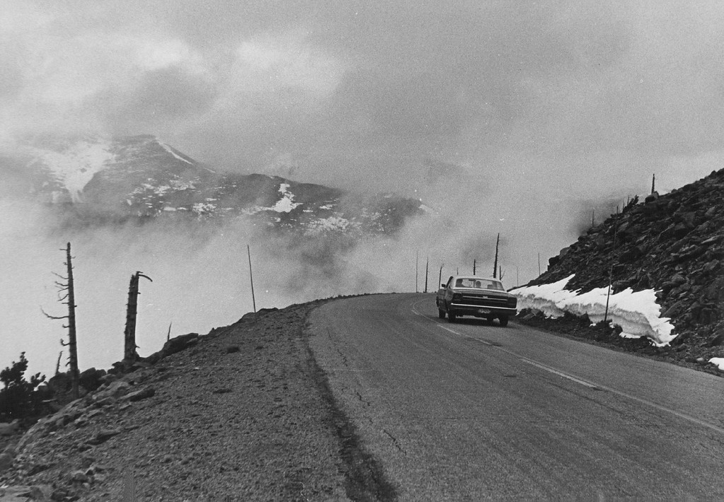. Eastbound Traffic Over Nations Highest Continuous Highway Began To Flow Again in 1968. After a few hours of sunshine those ragged remnants of once-towering snowbanks will melt into water. (Ira Gay Sealy/The Denver Post)