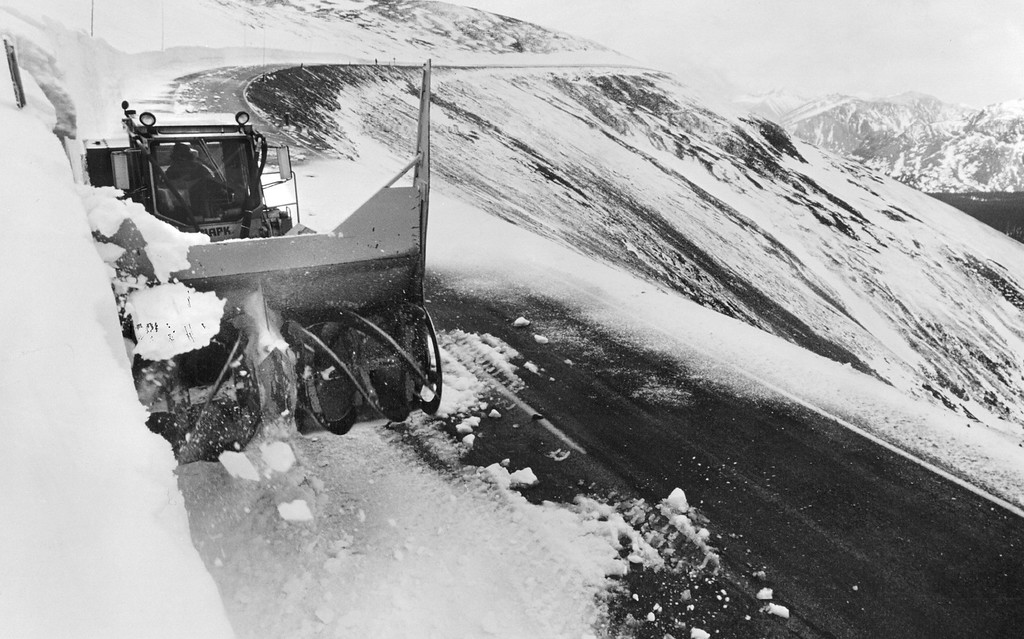 . Rotary snow plow operator Larry Lewis widened the roadway along a high-altitude section of Trail Ridge Road prior to its opening to the public in 1991. (Karl Gehring/The Denver Post)