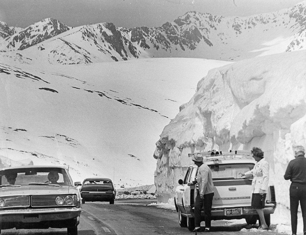 . Tourists from Boulder County at right pause near a big drift to take pictures and throw snowballs on Trail Ridge Road in Rocky Mountain National Park, 1968. Officials discourage motorists stopping near drifts, because of the danger of snowslides. (Duane Howell/The Denver Post)