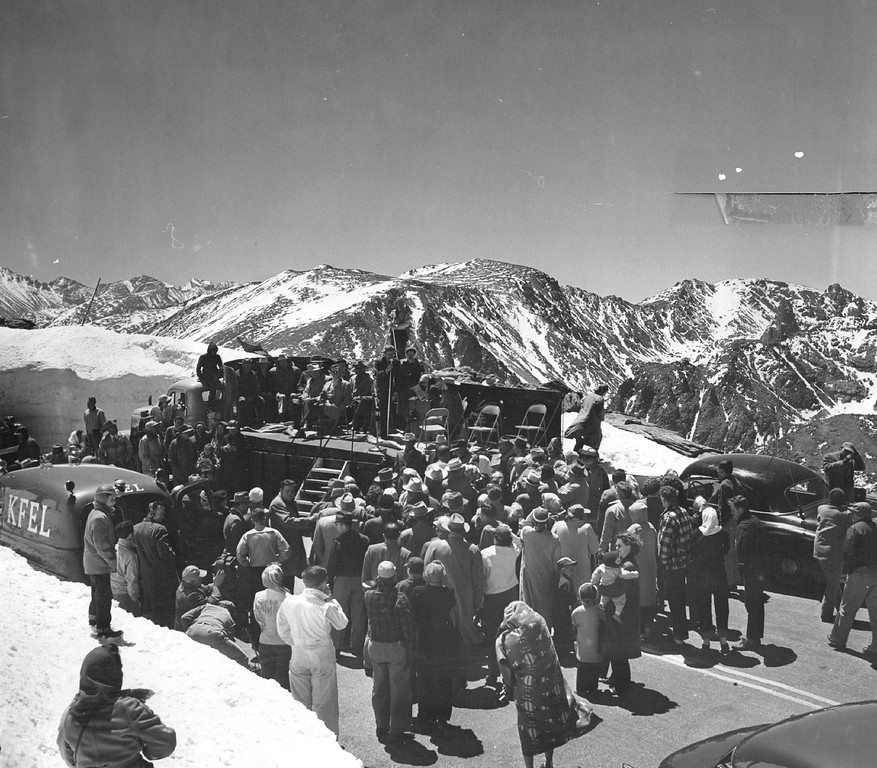 . More than 500 spectators gathered high on lofty Trail Ridge road to mark the opening of the transmountain highway through Rocky Mountain National park in 1953. Here is the scene as officials addressed the crowd during ceremonies opening the tourist road - one of the most heavily traveled in the west. An all-time record travel year is predicted at the park during 1953. (Denver Post Library photo archive)