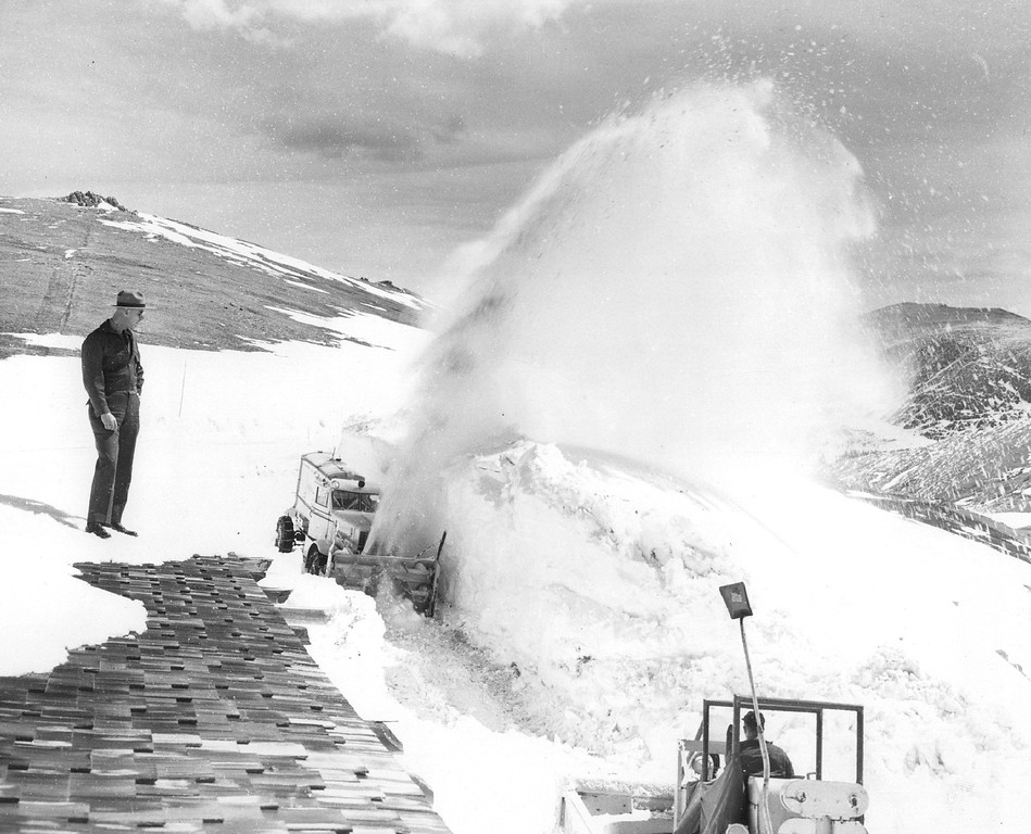 . Sending a plume of snow high into the air, a rotary plow and bulldozer team open the road around Fall River museum high on Trail Ridge Road in 1955. Watching snow removal work here is Ruben Hart, assistant chief ranger. (Donald C Cieber/The Denver Post)