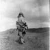 Title: The scout--Atsina.  <br /> Date Created/Published: c1908 November 19.  <br /> Summary: Atsina man, full-length portrait, standing, turned right, holding rifle while he looks over a grassy plain.  <br /> Photograph by Edward S. Curtis, Curtis (Edward S.) Collection, Library of Congress Prints and Photographs Division Washington, D.C.