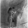Title: The primitive artists--Paviotso.  <br /> Date Created/Published: c1924 August 5.  <br /> Summary: Paviotso man standing, marking side of glacial boulder that already has petroglyphs on it.  <br /> Photograph by Edward S. Curtis, Curtis (Edward S.) Collection, Library of Congress Prints and Photographs Division Washington, D.C.