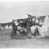 Title: Drying meat.  <br /> Date Created/Published: c1908 November 19.  <br /> Summary: Two Dakota women hanging meat to dry on poles, tent in background.  <br /> Photograph by Edward S. Curtis, Curtis (Edward S.) Collection, Library of Congress Prints and Photographs Division Washington, D.C.