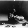 Title: Nunipayo decorating pottery.  <br /> Date Created/Published: c1900.  <br /> Summary: Woman seated on mat painting designs on pottery.  <br /> Photograph by Edward S. Curtis, Curtis (Edward S.) Collection, Library of Congress Prints and Photographs Division Washington, D.C.