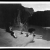 Title: At the old well of Acoma  <br /> Date Created/Published: c1904 November 12.  <br /> Summary: Acoma girl, seated on rock, watches as another girl fills a pottery vessel with water from a pool.  <br /> Photograph by Edward S. Curtis, Curtis (Edward S.) Collection, Library of Congress Prints and Photographs Division Washington, D.C.