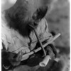 Title: Drilling ivory--King Island.  <br /> Date Created/Published: c1929 February 28.  <br /> Summary: Eskimo man, wearing hooded parka, manually drilling an ivory tusk.  <br /> Photograph by Edward S. Curtis, Curtis (Edward S.) Collection, Library of Congress Prints and Photographs Division Washington, D.C.