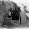 Title: Tewa girls.  <br /> Date Created/Published: c1900.  <br /> Summary: Two Tewa girls standing outside pueblo building.  <br /> Photograph by Edward S. Curtis, Curtis (Edward S.) Collection, Library of Congress Prints and Photographs Division Washington, D.C.