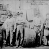 Bearded Irish clam diggers and a matronly companion on a wharf in Boston, 1882. (Courtesy of the National Archives)