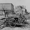 The ruins of Mills House and nearby buildings, Charleston, S.C. A shell-damaged carriage and the remains of a brick chimney in the foreground. 1865. Photograph by George N. Barnard. (Courtesy of the National Archives)
