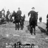 """""""Scenes of 1891 - Battle of Wounded Knee."""" Buffalo Bill, Capt. Baldwin, Gen. Nelson A. Miles, Capt. Moss, and others, on horseback, on battlefield of Wounded Knee. Ca. 1890. (Library of Congress Prints and Photographs Division)"""