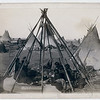 """Title: """"Home of Mrs. American Horse."""" Visiting squaws at Mrs. A's home in hostile camp<br /> Oglala women and children seated inside an uncovered tipi frame in an encampment--most are looking away from the camera--probably on or near Pine Ridge Reservation. 1891.<br /> Repository: Library of Congress Prints and Photographs Division Washington, D.C. 20540"""