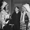 John Collier with tribal regalia  Dewey Beard, left, and James Pipe-on-Head,