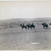 Title: General Miles and staff<br /> Six military men on horseback on a hill overlooking a large encampment of tipis. 1891. <br /> Repository: Library of Congress Prints and Photographs Division Washington, D.C. 20540
