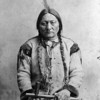Sitting Bull c1884. Sitting Bull was shot and killed when police tried to arrest him outside his house on the Standing Rock reservation on December 15, 1890. After his death, members of his Hunkpapa band followed Chief Spotted Elk to Wounded Knee. Palmquist & Jurgens, photographer. (Denver Public Library; Western History Collection)