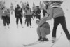 Eric Whitney, a ski instructor at Vail, helps skier Penny Conner up after she fell during a beginner ski class in January 1993. Kent Meireis, The Denver Post.  Denver Post Library photo archive