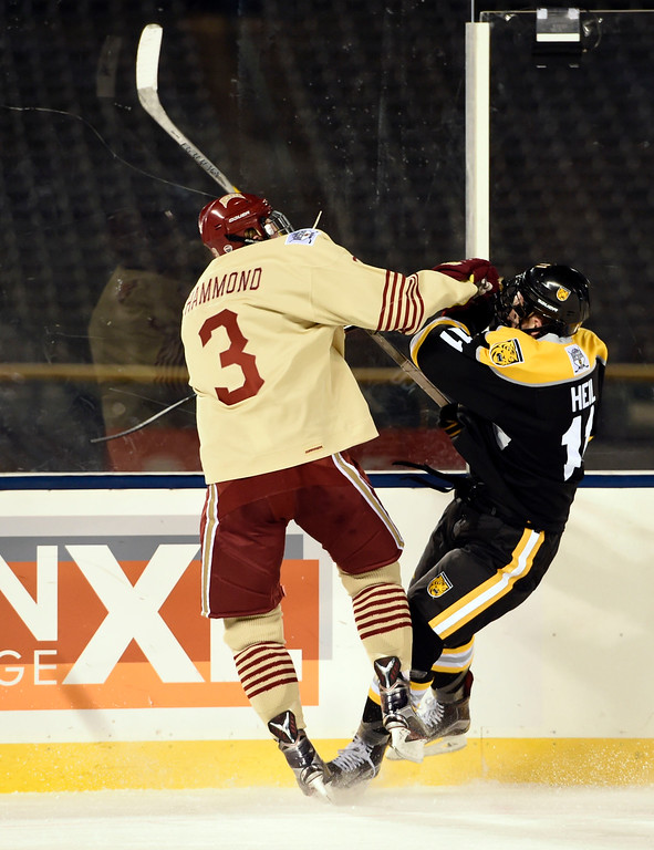 . Denver Pioneers defenseman Tariq Hammond (3) collides with Colorado College Tigers forward Christian Heil (11) in the first period during the Battle On Blake February 20, 2016 at Coors Field.  (Photo By John Leyba/The Denver Post)