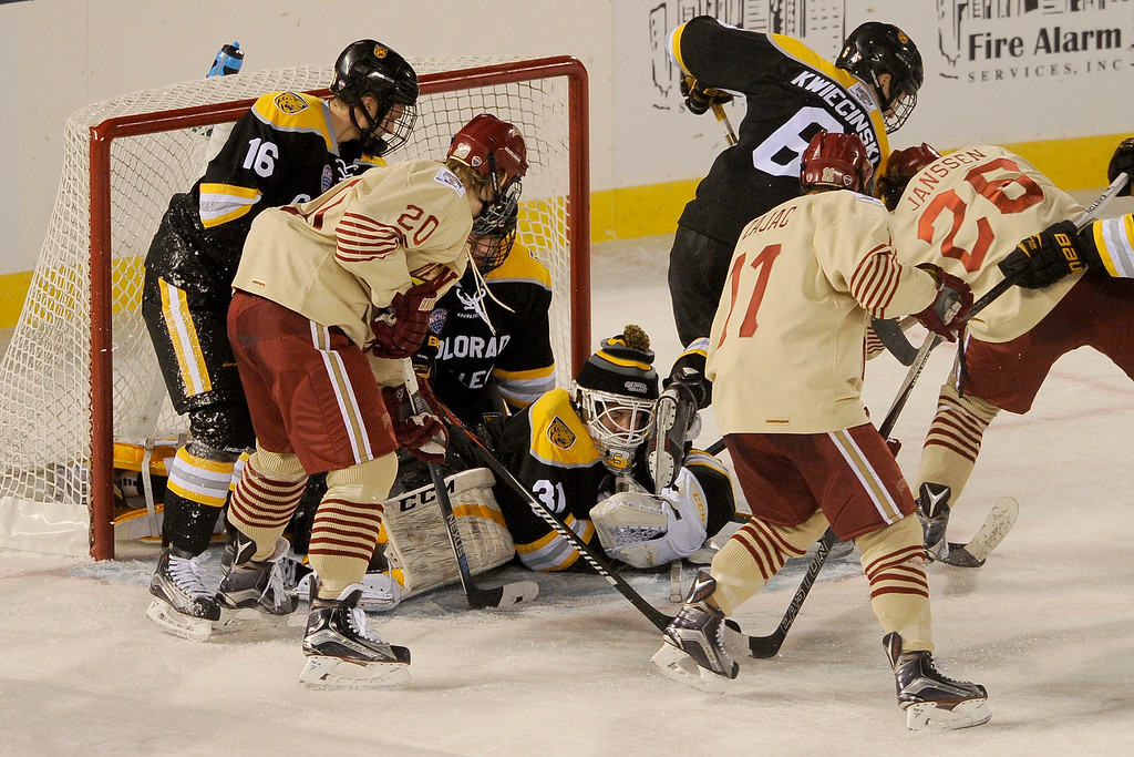 . Colorado College goalie Jacob Nehama (31) ends up on the bottom of a pile after players from both Colorado College and the University of Denver scrambled for a loose puck in front of the net during the second period at Coors Field in Denver, Colorado on February 20, 2016. (Photo by Seth McConnell/The Denver Post)