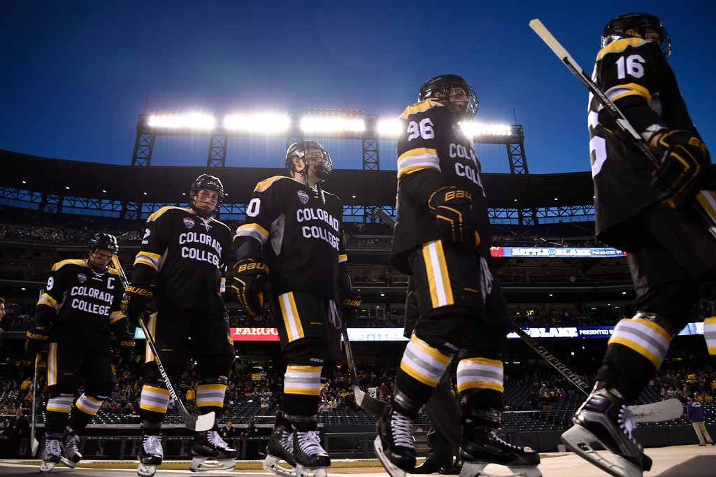 . Colorado College Tigers take to the ice to take on Denver Pioneers  during the Battle On Blake February 20, 2016 at Coors Field.  (Photo By John Leyba/The Denver Post)