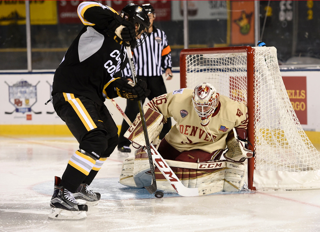 . Denver Pioneers goalie Tanner Jaillet (36) makes a save on a shot by Colorado College Tigers forward Hunter Fejes (18) in the second period during the Battle On Blake February 20, 2016 at Coors Field.  (Photo By John Leyba/The Denver Post)
