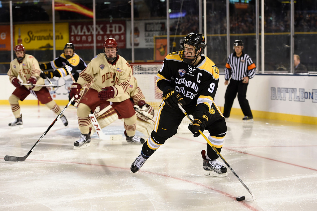. DColorado College Tigers forward Sam Rothstein (9) controls the puck in the second period against the Denver Pioneers during the Battle On Blake February 20, 2016 at Coors Field.  (Photo By John Leyba/The Denver Post)