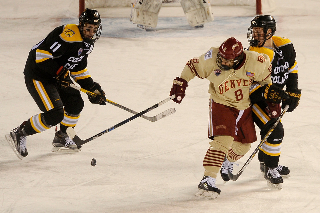 . Ben Israel (27) of Colorado College poke checks the puck free from the stick of Trevor Moore (8) of the University of Denver during the third period at Coors Field in Denver, Colorado on February 20, 2016. (Photo by Seth McConnell/The Denver Post)