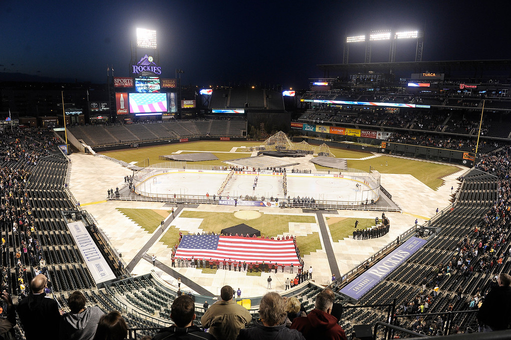 . A large American flag is displayed before the start of the Colorado College and University of Denver hockey game at Coors Field in Denver, Colorado on February 20, 2016. (Photo by Seth McConnell/The Denver Post)