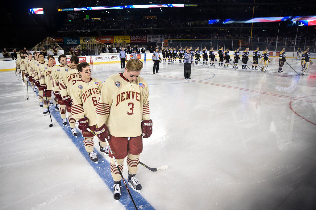 . Denver Pioneers and Colorado College stand for the national anthem during the Battle On Blake February 20, 2016 at Coors Field.  (Photo By John Leyba/The Denver Post)