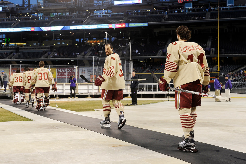 . Grant Arnold (39) of the University of Denver yells back to his teammates as they take the ice before their game against Colorado College at Coors Field in Denver, Colorado on February 20, 2016. (Photo by Seth McConnell/The Denver Post)