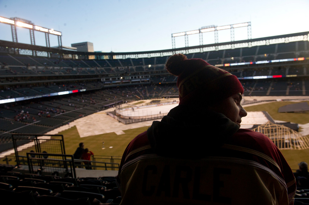 . Christian Juan watches the University of Denver and Colorado College warm up before the first period at Coors Field in Denver, Colorado on February 20, 2016. (Photo by Seth McConnell/The Denver Post)